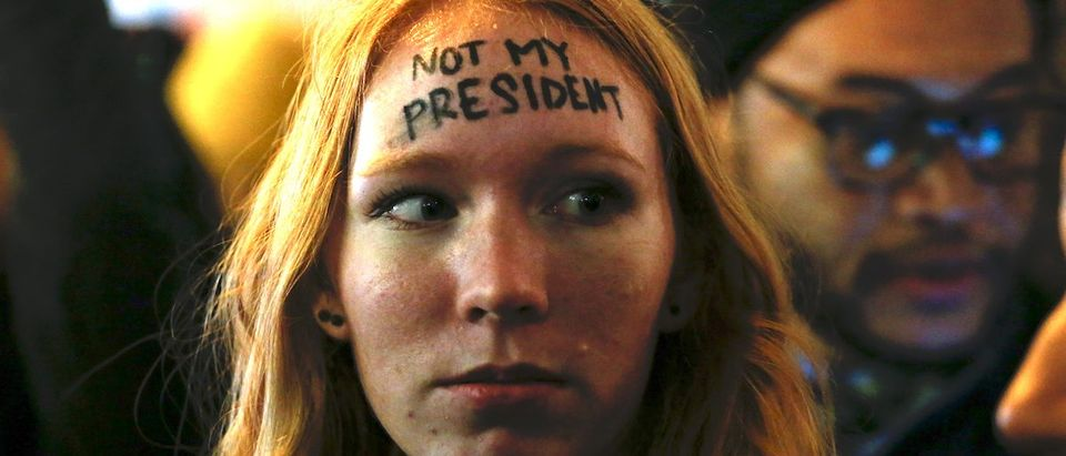 A woman looks on as she takes part in a protest against President-elect Donald Trump in front of Trump Tower in New York on November 10, 2016. (KENA BETANCUR/AFP/Getty Images)