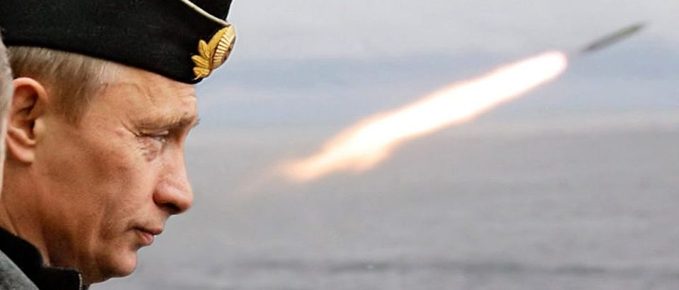 Russian President Putin watches the launch of a missile during naval exercises in Russia's Arctic ...
