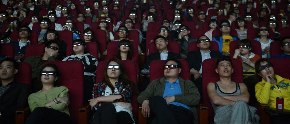 "People wearing 3D glasses watch the film ""Titanic 3D"" at a movie theatre in Taiyuan"