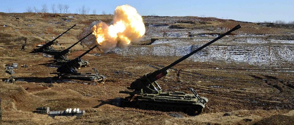 North Korea's artillery sub-units, whose mission is to strike Daeyeonpyeong island and Baengnyeong island of South Korea, conduct a live shell firing drill to examine war fighting capabilities in the western sector of the front line in this picture released by the North's official KCNA news agency in Pyongyang March 14, 2013. North Korean leader Kim Jong-un and military officers attended the live shell firing drill. REUTERS/KCNA