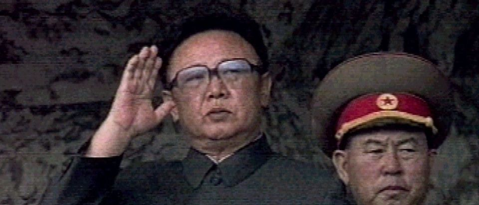 North Korean leader Kim Jong-il salutes during a ceremony commemorating North Korea's 50th anniversary of the founding of the state in Pyongyang September 9. North Korea celebrated its 50th anniversary with a grand military parade featuring banners hailing long life for the country's late founder, Kim Il-sung. SB/Reuters