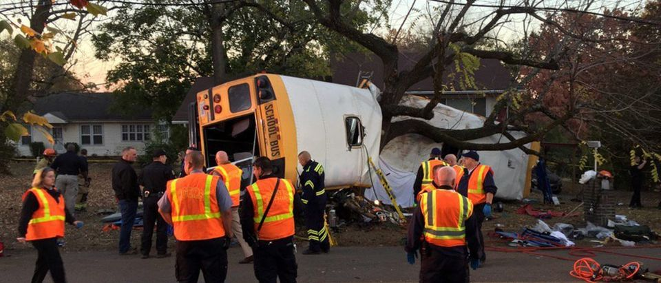 Rescue officials at the scene of a school bus crash involving several fatalities in Chattanooga, Tennessee, U.S., November 21, 2016. Courtesy of Chattanooga Fire Dept/Handout via REUTERS