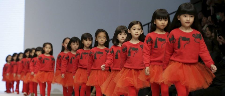 Models present creations for M.latin children's wear collection at China Fashion Week S/S 2016 in Beijing