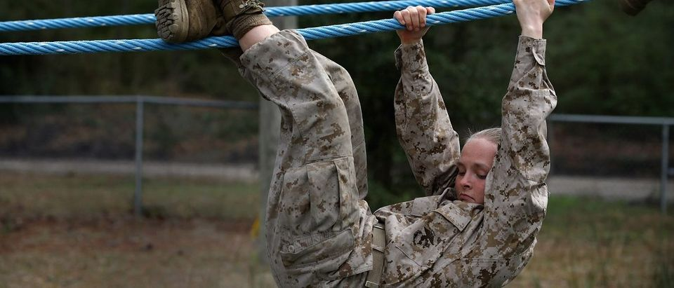 Marine recruit Trenia Tully of Charlotte, Michigan navigates an obstacle on the Confidence Course during boot camp February 27, 2013 at MCRD Parris Island, South Carolina. Female enlisted Marines have gone through recruit training at the base since 1949. About 11 percent of female recruits who arrive at the boot camp fail to complete the training, which can be physically and mentally demanding. On January 24, 2013 Secretary of Defense Leon Panetta rescinded an order, which had been in place since 1994, that restricted women from being attached to ground combat units. About six percent of enlisted Marines are female. (Photo by Scott Olson/Getty Images)