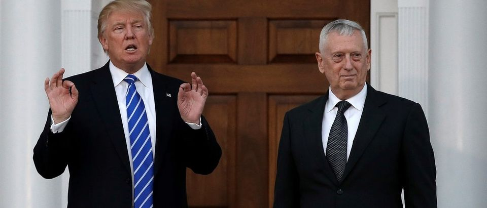 U.S. President-elect Donald Trump stands with retired Marine Gen. James Mattis following their meeting at the main clubhouse at Trump National Golf Club in Bedminster