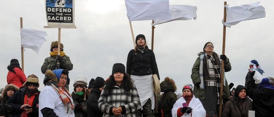 Women hold a demonstration on Backwater Bridge during a protest against plans to pass the Dakota Access pipeline near the Standing Rock Indian Reservation, near Cannon Ball, North Dakota, U.S.