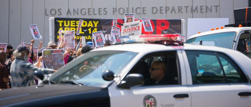 Police observing people in front of Los Angeles Police Department during Stop Murder by Police. (Photo: Shutterstock)