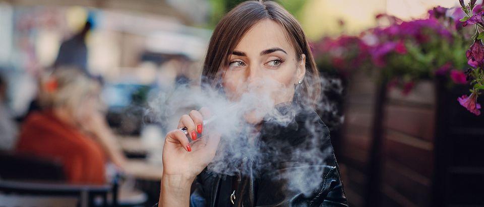 Woman vaping (Credit: Oleg Baliuk/Shutterstock)