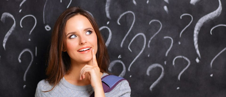 A confused woman ponders postmodernist nonsense. (Credit: sheff/Shutterstock)