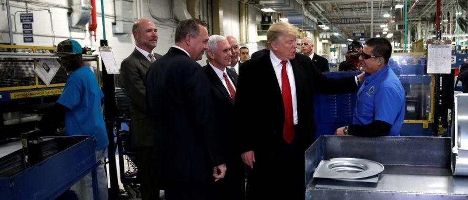 U.S. President-elect Donald Trump greets a worker as he tours a Carrier factory with Greg Hayes, CEO of United Technologies (L) in Indianapolis