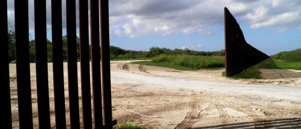 A gap to make way for a road in the U.S. border fence is seen in Brownsville