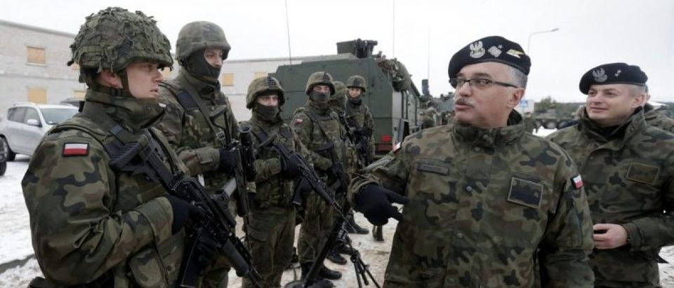 Poland's troops along with the other troops from 11 NATO nations take part in the exercise in urban warfare during Iron Sword exercise in the mock town near Pabrade