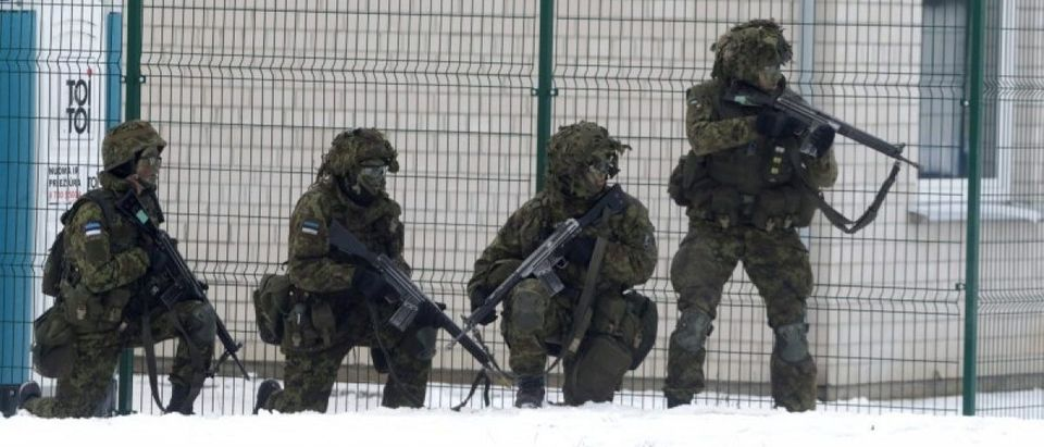Estonian troops along with other troops from 11 NATO nations take part in the exercise in urban warfare during Iron Sword exercise in the mock town near Pabrade