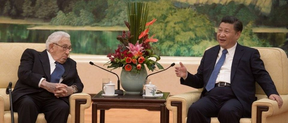 Former U.S. Secretary of State Henry Kissinger meets China's President Xi Jinping at the Great Hall of the People in Beijing