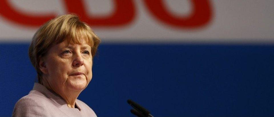 German Chancellor and leader of the conservative CDU Angela Merkel walks inside the Grugahalle in Essen