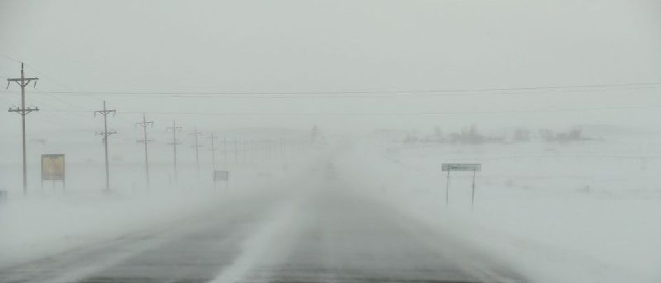 The wind blows snow across highway 1806 as a blizzard hits the Standing Rock Indian Reservation, near Fort Yates, North Dakota