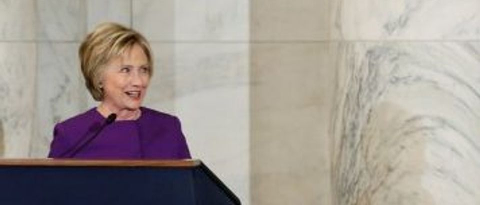 Clinton and Schumer participate in a ceremony to unveil a portrait honoring retiring Reid on Capitol Hill in Washington