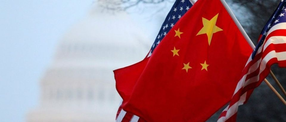 Chinese flag and the U.S. Stars and Stripes fly along Pennsylvania Avenue near the U.S. Capitol in Washington
