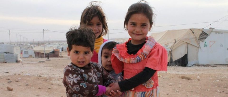 Syrian children pose for a picture at Jordan's Al Zaatari refugee camp
