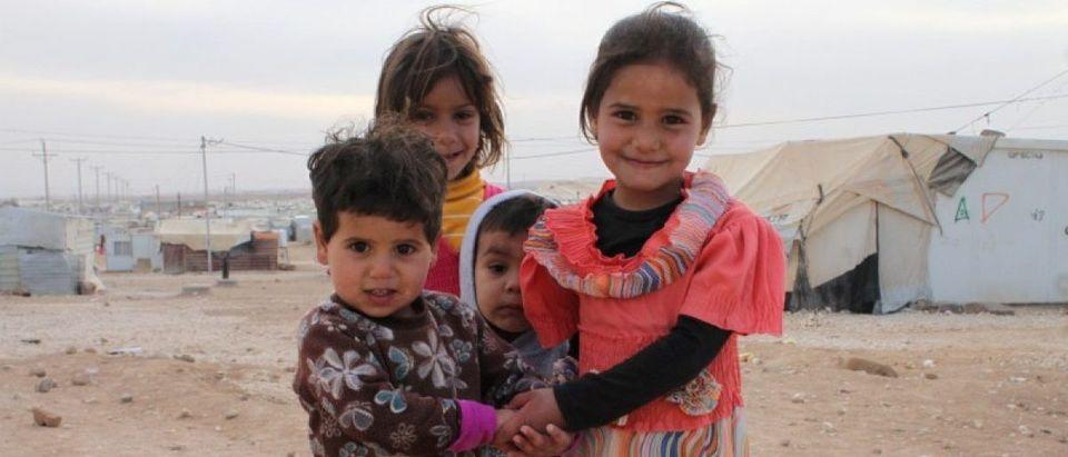 Syrian children pose for a picture at Jordan's Al Zaatari refugee camp