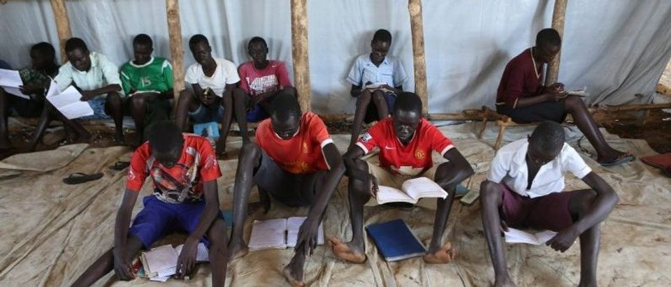 Youth who fled fighting in South Sudan attend classes in a tent at Bidi Bidi refugee's resettlement camp near the border with South Sudan, in Yumbe district