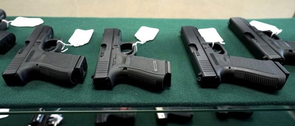A selection of Glock pistols are seen for sale at the Pony Express Firearms shop in Parker