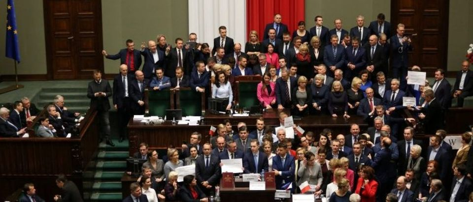 Polish opposition parliamentarians protest against the rules proposed by the head office of the Sejm, the lower house of parliament in the Parliament in Warsaw