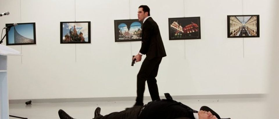 Russian Ambassador to Turkey Andrei Karlov lies on the ground after he was shot by unidentified man at an art gallery in Ankara