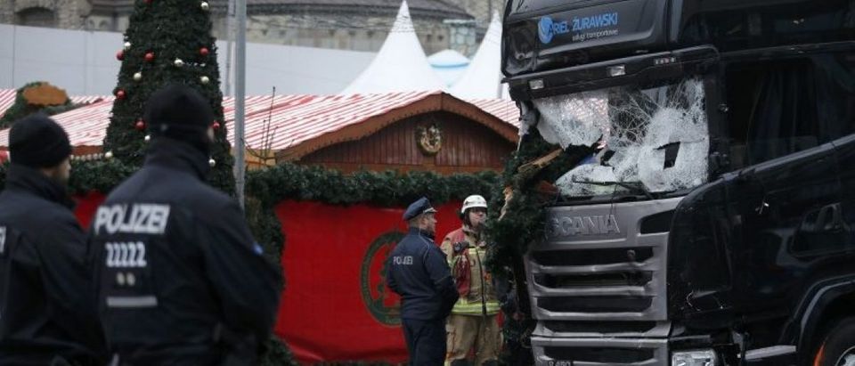 Police stand in front of the truck which ploughed last night into a crowded Christmas market in the German capital Berlin