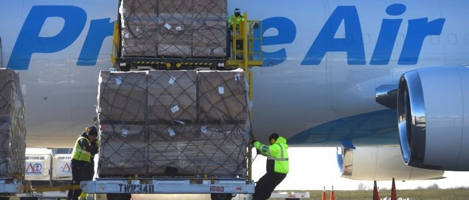 Workers unload a wide body aircraft emblazoned with Amazon's Prime logo at Lehigh Valley International Airport in Allentown, Pennsylvania, U.S.