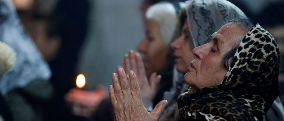 Iraqi Christians attend a mass on Christmas eve at the Mar Shemoni church in the town of Bartella east of Mosul