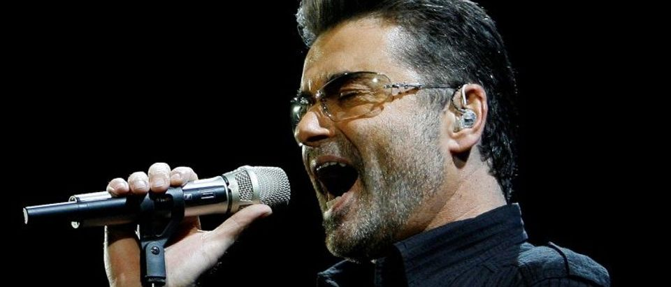 """FILE PHOTO: George Michael performs in concert at the Forum during his """"Live Global Tour"""" in Inglewood"""