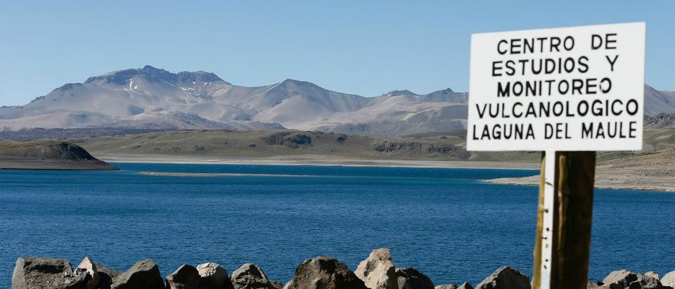 "The Laguna del Maule (Lagoon of Maule) is seen in the VII region of Talca, south of Santiago, Chile November 29, 2016. The sign reads, ""Center of monitoring and volcanological studies, Laguna del Maule"". REUTERS/Rodrigo Garrido"