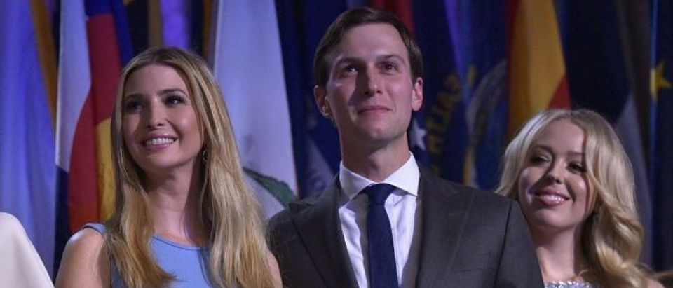 Ivanka Trump, her husband Jared Kushner and Tiffany Trump smile as Republican presidential elect Donald Trump speaks during election night at the New York Hilton Midtown in New York on November 9, 2016. (MANDEL NGAN/AFP/Getty Images)