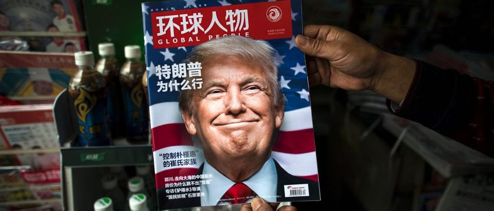 """A copy of the local Chinese magazine Global People with a cover story that translates to """"Why did Trump win?"""" JOHANNES EISELE/AFP/Getty Images."""