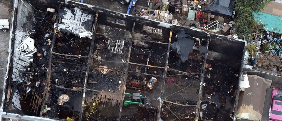 This aerial photo shows the remains of a fire ravaged warehouse on December 05, 2016 that killed at least 36 people in Oakland, California. (JOSH EDELSON/AFP/Getty Images)