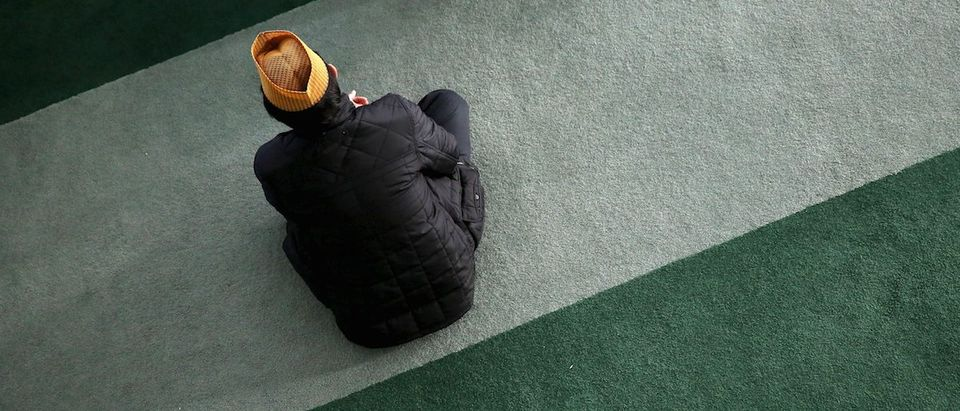 A Muslim attends Friday prayer at the Baitul Futuh Mosque in Morden