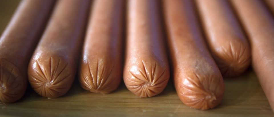 Hot dogs are pictured on a table following a bunless hot dog eating competition in the Manhattan borough of New York