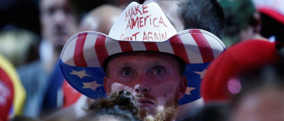 A supporter of Republican presidential nominee Donald Trump waits in the crowd before a campaign rally in Toledo