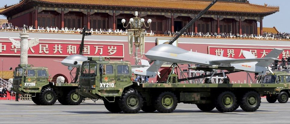 Military vehicles carrying Pterodactyl I unmanned aerial vehicles drive past the Tiananmen Gate during a military parade to mark the 70th anniversary of the end of World War Two, in Beijing