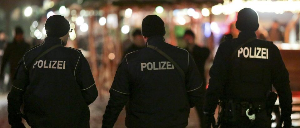 German police officers guard a Christmas market in the Prenzlauer Berg district in Berlin