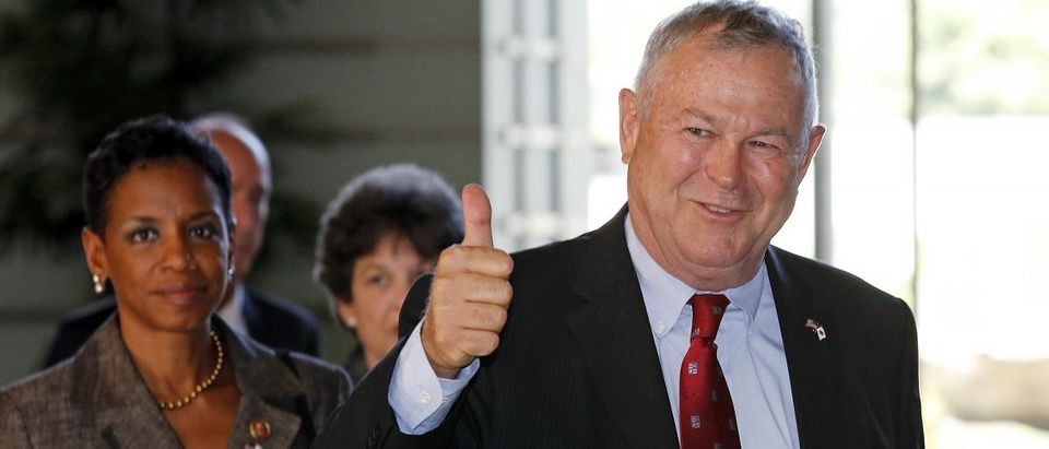 U.S. Representative Dana Rohrabacher gestures as his U.S. Congressional delegation arrives to meet Japanese Prime Minister Shinzo Abe at the Prime Minister's official residence in Tokyo