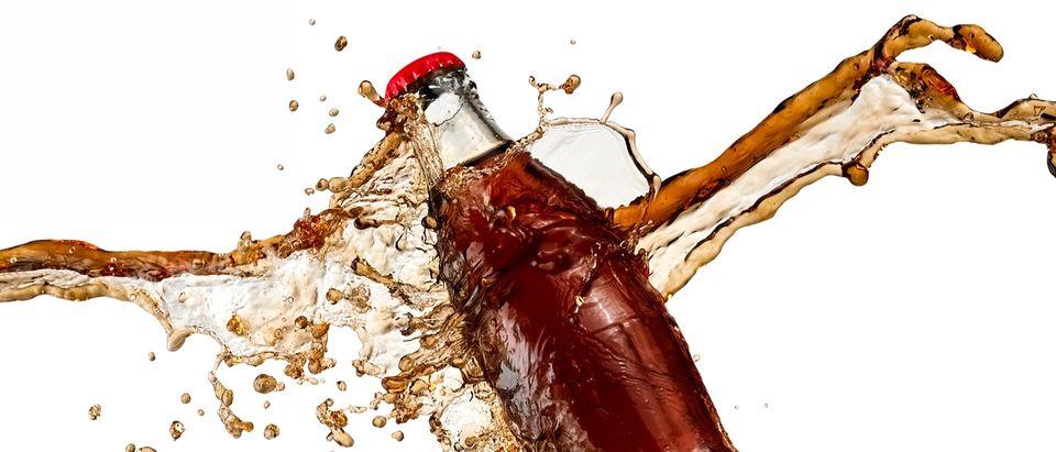 Soda bottle smashes against cold, hard reality. (Photo: Mariyana M/Shutterstock)