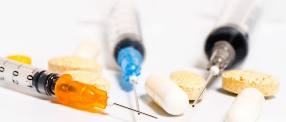 Needles, syringes, and pills for euthanasia are shown here. [Shutterstock - AH86] | Judge Strikes CA's Assisted Suicide