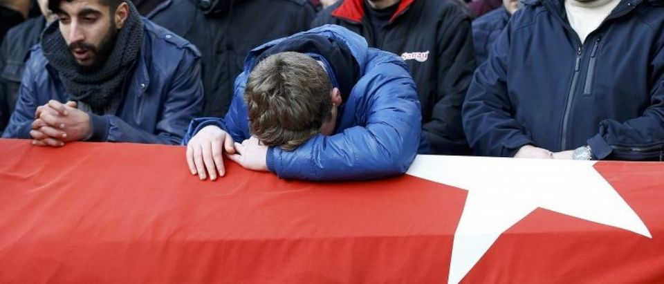 Relatives react at the funeral of Arik, a victim of an attack by a gunman at Reina nightclub, in Istanbul