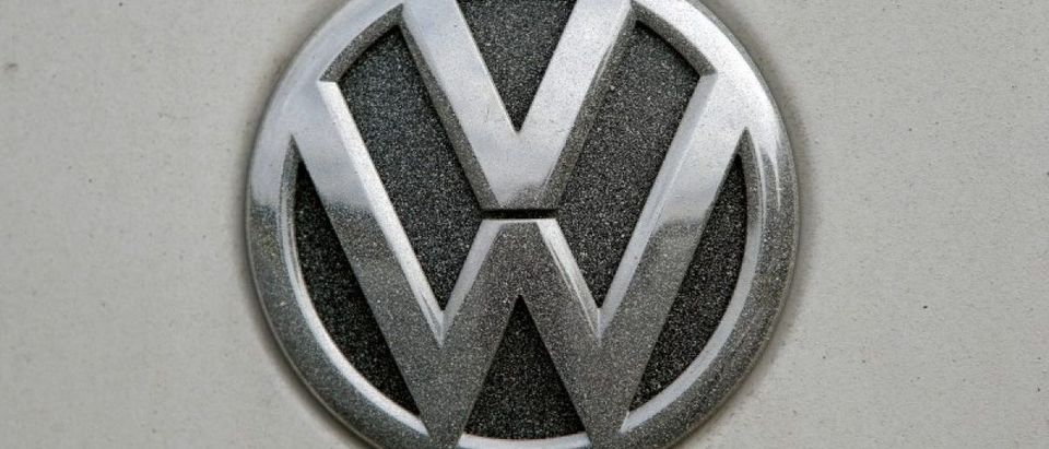 FILE PHOTO: A VW logo covered with dust is seen in Grafenwoehr