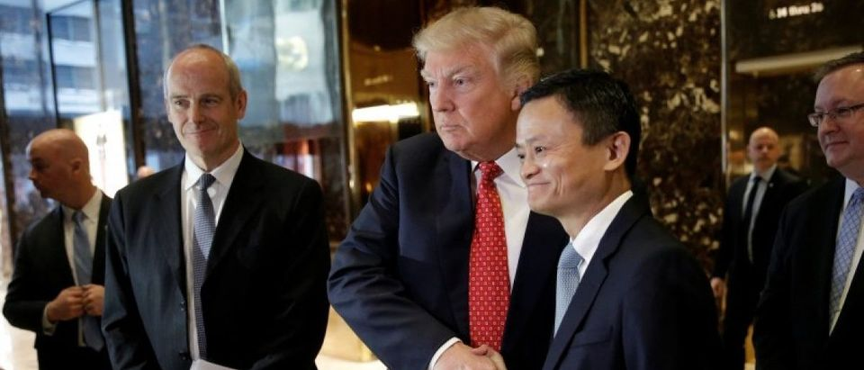 U.S. President-elect Donald Trump shakes hands with and Alibaba executive chairman Jack Ma after their meeting at Trump Tower in New York
