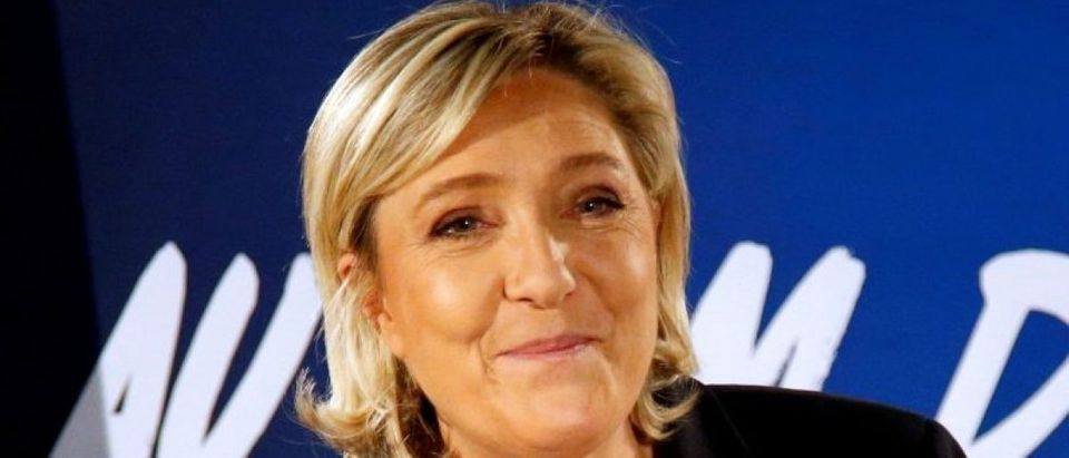 FILE PHOTO: Marine Le Pen, French far-right National Front (FN) party president, member of European Parliament and candidate in the French 2017 presidential election, speaks to the media in Paris