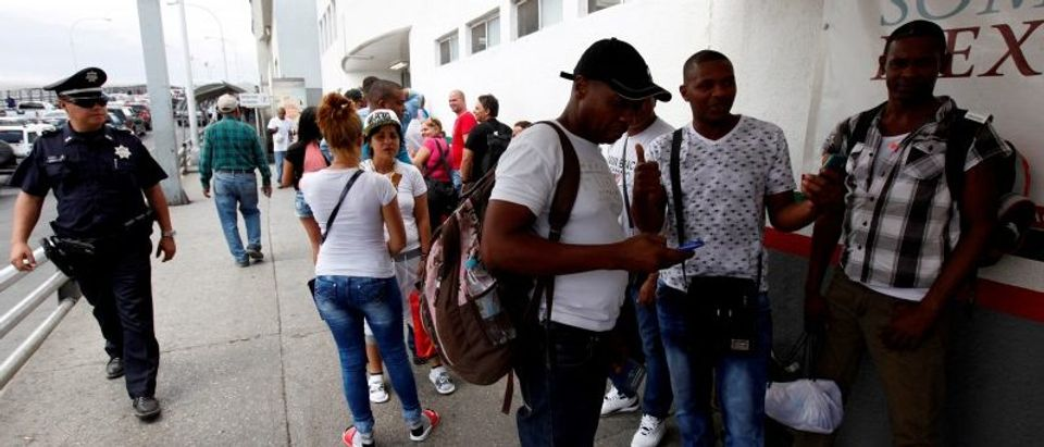 FILE PHOTO: Cuban migrants line up after arriving by plane from Panama to Mexico, as they make their way to the U.S., in Ciudad Juarez, at the Mexican border crossing with El Paso