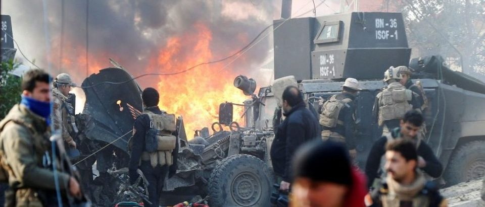 Iraqi Special Operations Forces (ISOF) react after a car bomb exploded during an operation to clear the al-Andalus district of Islamic State militants, in Mosul